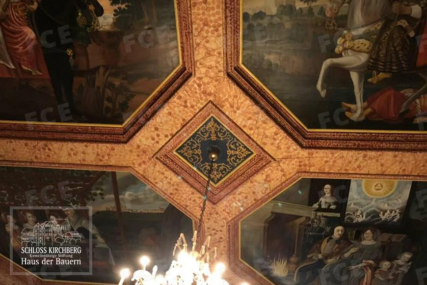 The ceiling is decorated with beautiful paintings